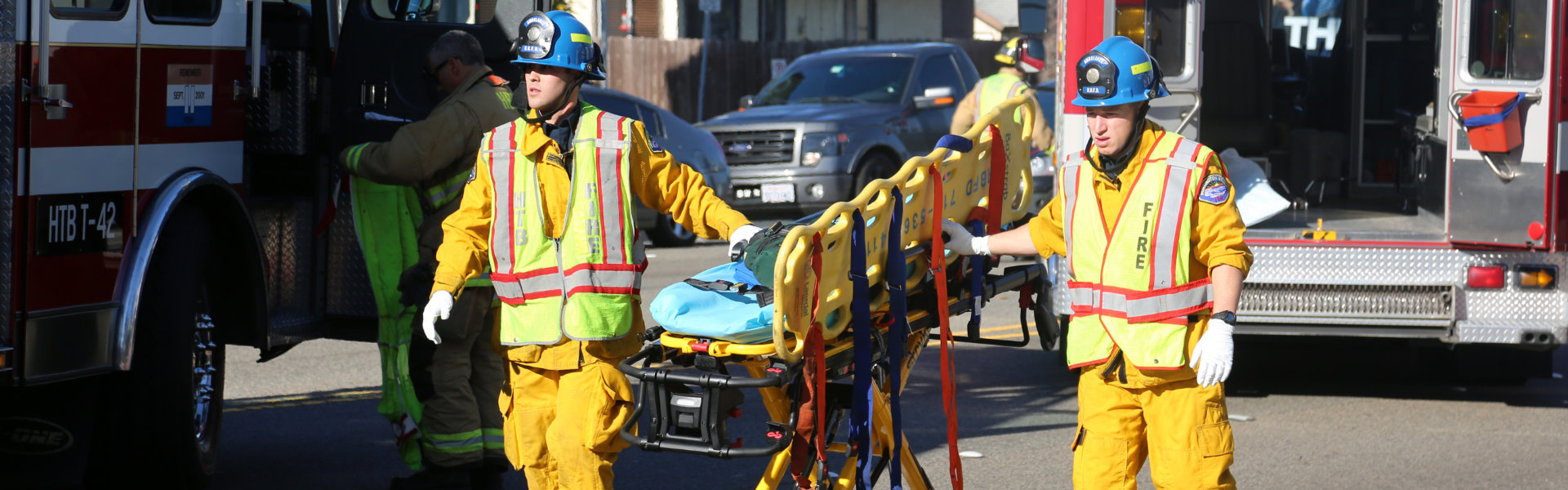 paramedics carry stretchers