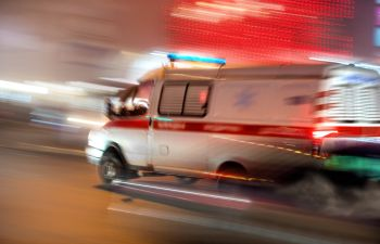 Ambulance Speeding Away From Accident